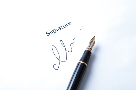 pen and signature on a white closeup Stock Photo - 27997167