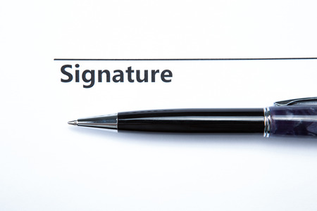 pen and signature on a white closeup Stock Photo - 27997168