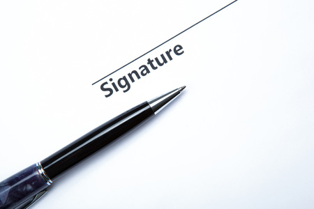 pen and signature on a white closeup Stock Photo - 27997170