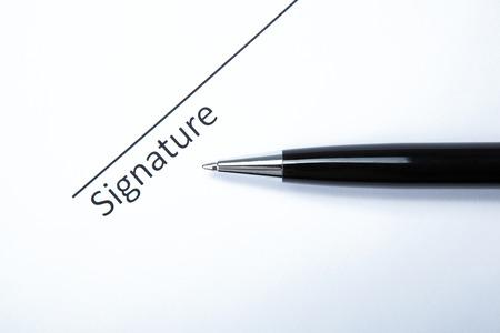 pen and signature on a white closeup Stock Photo - 27997171