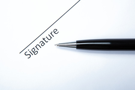 pen and signature on a white closeup Stock Photo - 27997171
