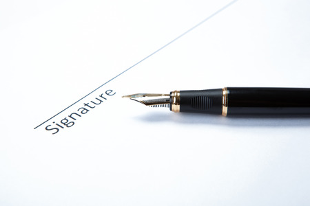 pen and signature on a white closeup Stock Photo - 27997173