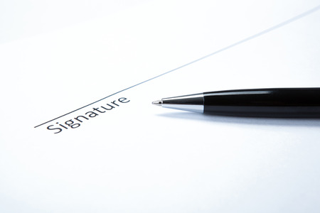 pen and signature on a white closeup Stock Photo - 27997174