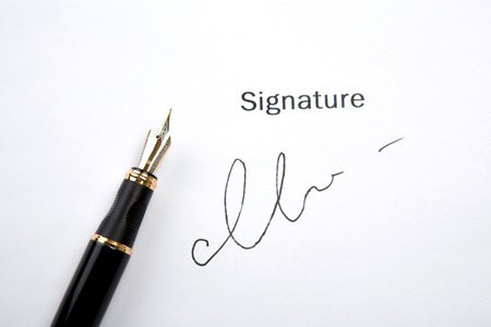 stipulation: pen and signature on a white closeup
