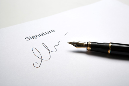 pen and signature on a white closeup Stock Photo - 27997297