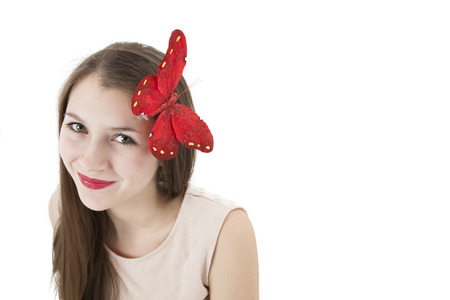 pomatum: portrait of a girl with a butterfly on her head on a white background