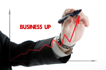 diagram with the word business up and the person starts to write by marker photo