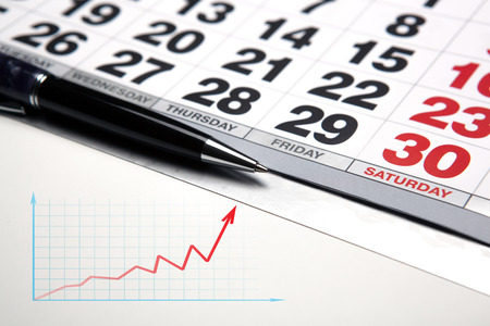 tabulation: wall calendar with pen closeup and macro