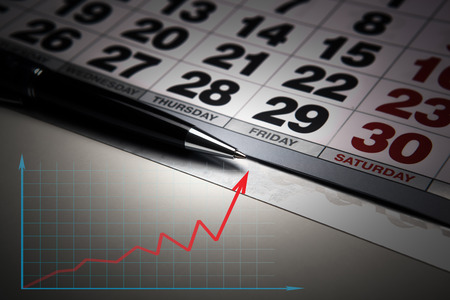 tabulation: wall calendar with pen closeup and macro