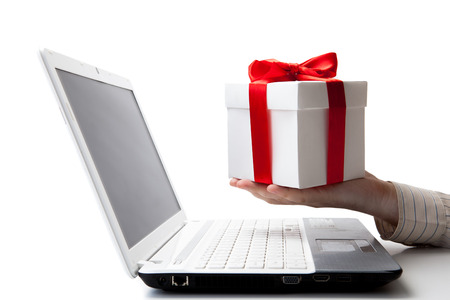 giving a gift online on a laptop on a white photo