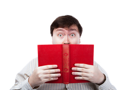 undergrad: man in stress holding an open red book closeup on a white