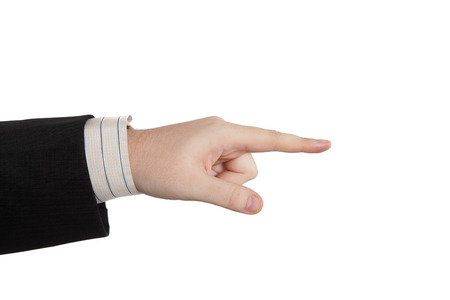 indicates: mans hand indicates on a white
