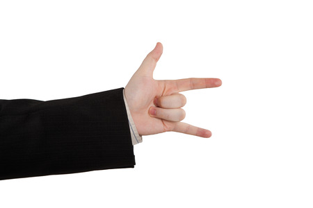 indicates: mans hand indicates horns on a white Stock Photo