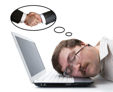 undergrad: employee at the computer dreaming agreement on a white  Stock Photo