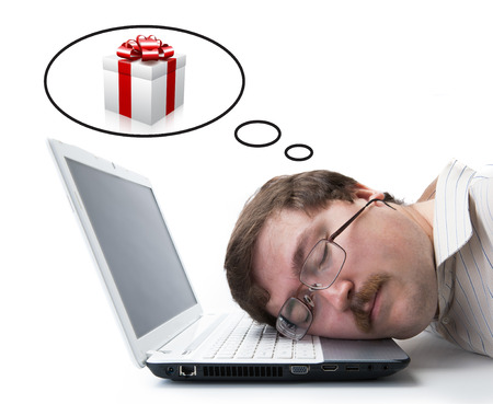 undergrad: employee for computer dream gift on a white Stock Photo
