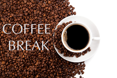 repose: cup of black coffee and roasted coffe beans on a white background Stock Photo