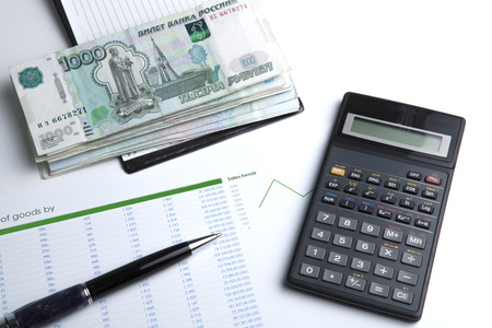 business still-life with banknotes and calculator closeup photo