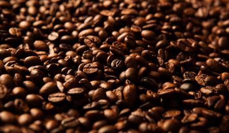 liveliness: roasted coffee beans background closeup and macro
