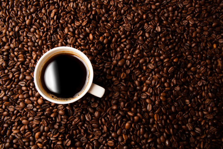 coffe beans: cup of black coffee and roasted coffe beans background Stock Photo