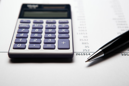 work on the calculator and papers close up photo
