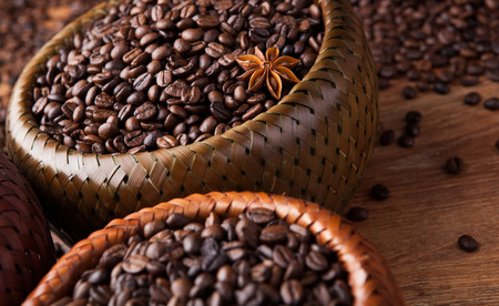 liveliness: roasted coffee beans in a bamboo basket close up