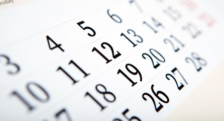 white calendar days with numbers close up Standard-Bild