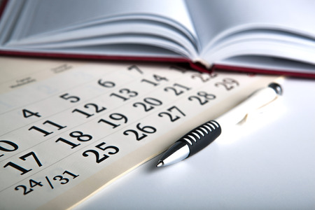 dispositions: calendar days with numbers and pen close up