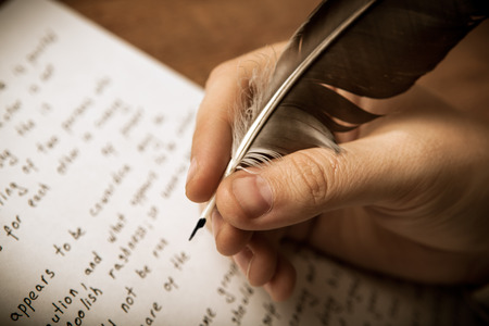 writer writes a fountain pen on paper work close up