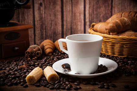 Coffee still life with cup of coffee with wood background photo