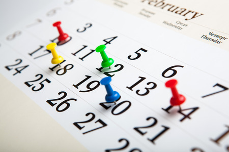 large wall calendar with number of days needles close-up
