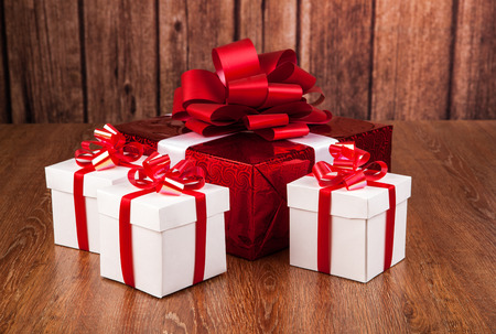 boxing day: one red gift box white gift boxes on a wood background