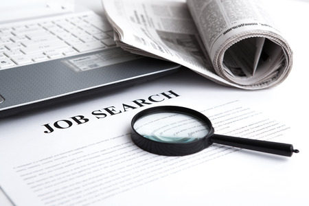 document with the title of job search with newspaper closeup Foto de archivo