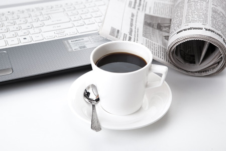 business still life and cup of coffee and newspaper
