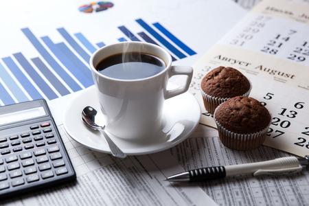 ビジネスの静物と新聞とコーヒーのカップ 写真素材