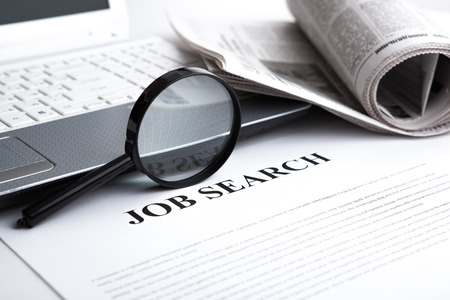 document with the title of job search with newspaper closeup photo