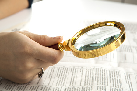 worker examines a magnifying glass text close up photo