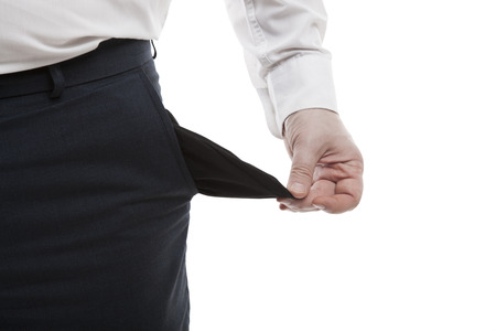 beggary: mans hand turns empty pocket on a white background