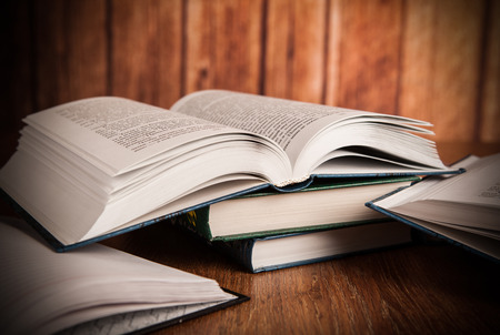 stack of books on a wood background Stock Photo