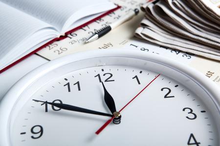 horologe: business stil life with clockface close up
