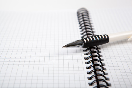 dispositions: pen on a notebook into a cell close up Stock Photo