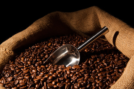 balmy: roasted coffee beans with scoop in bag close up Stock Photo