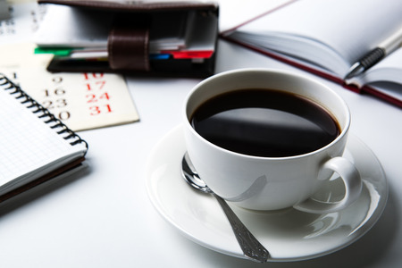 meal time: cup of black coffee, office supplies, close up