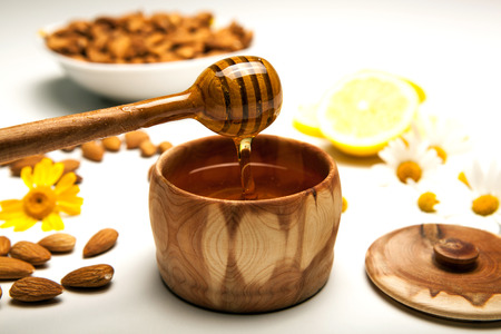 tableware life: Still life of honey, tableware, flowers, nuts, close up Stock Photo