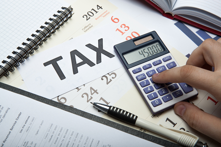 imposition: office work and filling in tax returns close up
