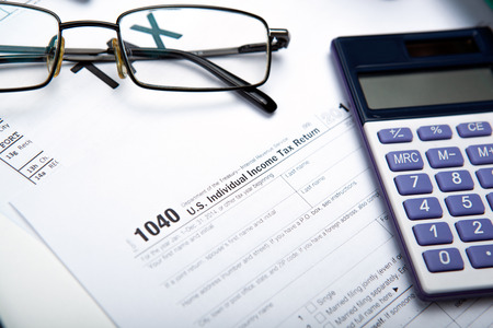 tax returns: office work and filling in tax returns close up