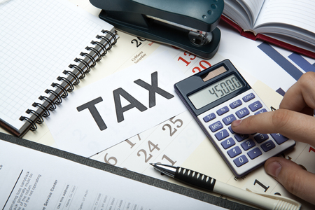 office work and filling in tax returns close up