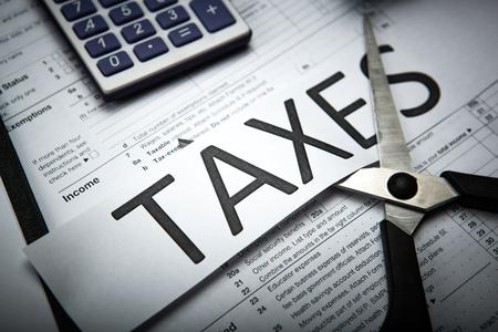 オフィスワークや税金の支払いのための隠喩 写真素材