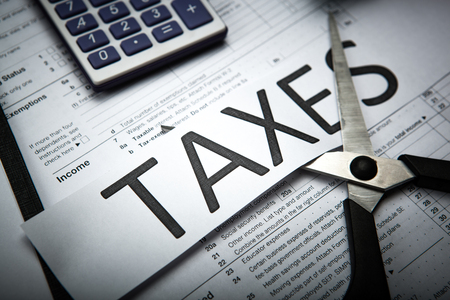 office work and metaphor for the payment of taxes Stock Photo