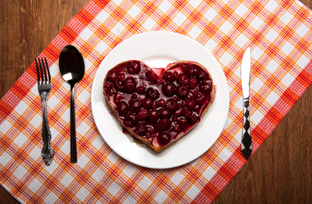 elegant party: raspberry pie in the form of heart close up