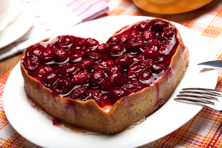 tea party: raspberry pie in the form of heart close up